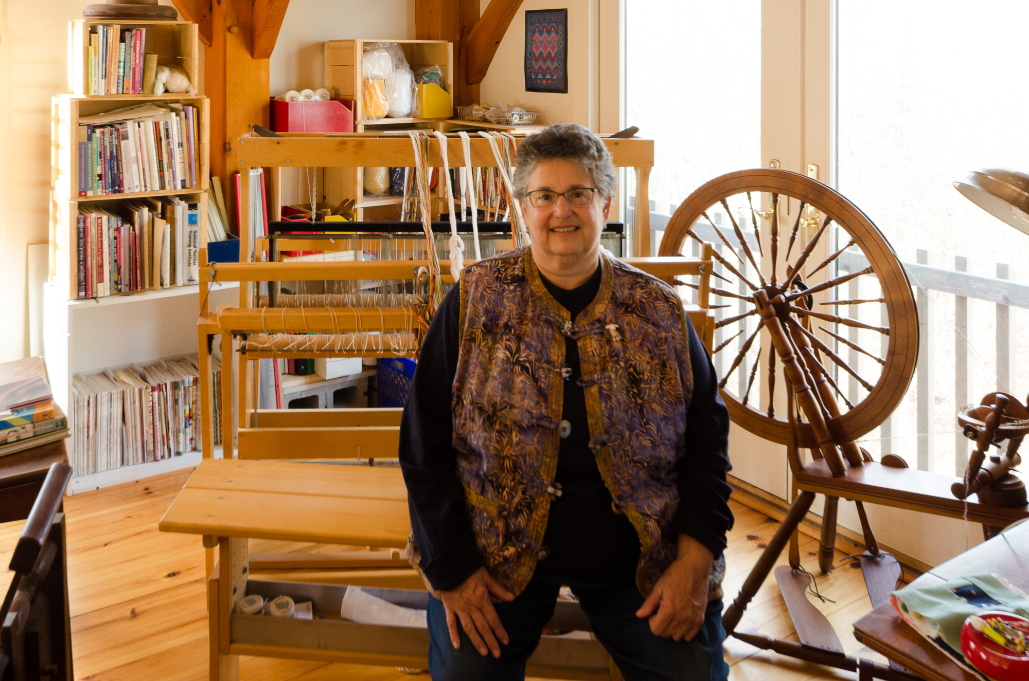 Nina Ruit seated in her spinning, weaving and sewing studio at Ruit Farm, Bristol. Nina is one of twenty destinations included in our Fiber Art Mini Tour: Midcoast Maine.